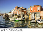 The picturesque island of Murano in the Venetian Lagoon is interwoven with canals and narrow streets between historic houses and palaces with beautiful gardens. Venice, Italy. Стоковое фото, фотограф Zoonar.com/Pavel REZAC / easy Fotostock / Фотобанк Лори