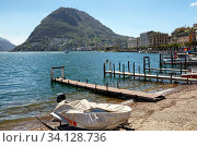 City of Lugano at the lake Lugano on a spring sunny day. View of the San Salvatore mountain. Lugano, canton of Ticino, Switzerland, Europe. (2018 год). Стоковое фото, фотограф Bala-Kate / Фотобанк Лори