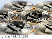 Купить «Macro view of shiny Bitcoin souvenire coins on light background, selective focus», фото № 34131276, снято 2 июля 2020 г. (c) easy Fotostock / Фотобанк Лори