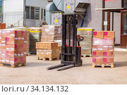 Russia Samara April 2020: Electric self-propelled stacker for periodic storage and transportation of pallets with cargo. Редакционное фото, фотограф Акиньшин Владимир / Фотобанк Лори