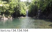 Вид с лагуны на водопад острова Тавеуни (2019 год). Стоковое фото, фотограф Юрий Хабаров / Фотобанк Лори