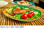 Zamin Doz - whole fish is stuffed with spices. Стоковое фото, фотограф Zoonar.com/alexander mychko / easy Fotostock / Фотобанк Лори