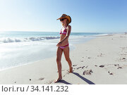 Купить «Beautiful woman walking on the beach», фото № 34141232, снято 25 февраля 2020 г. (c) Wavebreak Media / Фотобанк Лори
