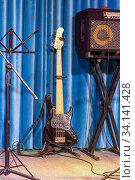 Купить «Electric guitar and stage amplifier», фото № 34141428, снято 22 июня 2020 г. (c) Евгений Ткачёв / Фотобанк Лори