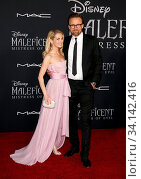 Joachim Rønning and Amanda Hearst at the World premiere of Disney's 'Maleficent: Mistress Of Evil' held at the El Capitan Theatre in Hollywood, USA on September 30, 2019. Стоковое фото, фотограф Zoonar.com/Lumeimages.com / age Fotostock / Фотобанк Лори