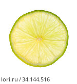 Thin slice of fresh lime lit from behind isolated on white background. Стоковое фото, фотограф Zoonar.com/Valery Voennyy / easy Fotostock / Фотобанк Лори