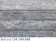 Construction background - stack of gray railway sleepers made of recycled composite materials. Стоковое фото, фотограф Zoonar.com/Valery Voennyy / easy Fotostock / Фотобанк Лори