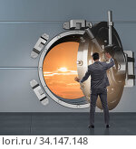 Businessman in banking concept with vault door. Стоковое фото, фотограф Elnur / Фотобанк Лори