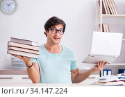 Купить «Young handsome student preparing for school exams», фото № 34147224, снято 3 июля 2018 г. (c) Elnur / Фотобанк Лори