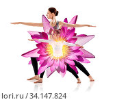 Купить «Double exposure of mother with daughter doing yoga exercise and lotus flower over white background», фото № 34147824, снято 4 июля 2020 г. (c) age Fotostock / Фотобанк Лори
