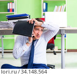 Купить «Frustrated businessman stressed from excessive work», фото № 34148564, снято 1 июня 2018 г. (c) Elnur / Фотобанк Лори
