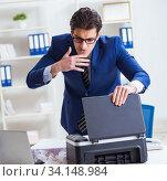Купить «Businessman angry at copying machine jamming papers», фото № 34148984, снято 8 декабря 2017 г. (c) Elnur / Фотобанк Лори