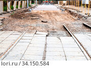Repair of tram tracks in Moscow city - disassembled tram road and laying of new rails on the tram track. Стоковое фото, фотограф Zoonar.com/Valery Voennyy / easy Fotostock / Фотобанк Лори