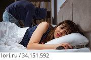 Купить «Burglar breaking into house at night to bedroom with sleeping wo», фото № 34151592, снято 9 августа 2017 г. (c) Elnur / Фотобанк Лори