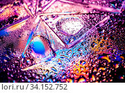 Купить «Abstract trendy holographic background in the style of the 80-90s. Real texture of broken glass or ice and water drops in bright acid colors. Synthwave Vaporwave webpunk Massurrealism aesthetics.», фото № 34152752, снято 12 июля 2020 г. (c) easy Fotostock / Фотобанк Лори