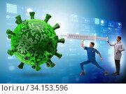 Coronavirus covid-19 vaccine concept with doctors and syringe. Стоковое фото, фотограф Elnur / Фотобанк Лори