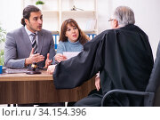 Купить «Young woman in courthouse with judge and lawyer», фото № 34154396, снято 25 ноября 2019 г. (c) Elnur / Фотобанк Лори
