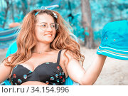 Portrait of a beautiful young woman with luxurious curly hair on nature on a summer day. Стоковое фото, фотограф Акиньшин Владимир / Фотобанк Лори