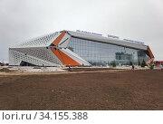 Купить «Строительство легкоатлетического спортивного комплекса в столице Казахастана Нур-Султане», фото № 34155388, снято 3 июля 2020 г. (c) Максим Гулячик / Фотобанк Лори