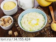 Millet porridge with milk. Стоковое фото, фотограф Надежда Мишкова / Фотобанк Лори