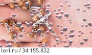 Купить «Covid-19 cells against hands holding rosary», фото № 34155832, снято 13 июля 2020 г. (c) Wavebreak Media / Фотобанк Лори