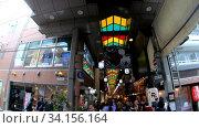 Купить «Slow motion video of the Nishiki Market, the popular food spot, located in Central Kyoto. Japan», видеоролик № 34156164, снято 19 июня 2020 г. (c) Serg Zastavkin / Фотобанк Лори