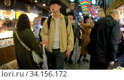 Купить «Slow motion video of the Nishiki Market, the popular food spot, located in Central Kyoto. Japan», видеоролик № 34156172, снято 21 июня 2020 г. (c) Serg Zastavkin / Фотобанк Лори