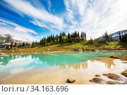Serenity lake in the mountains in summer season. Beautiful natural landscapes. Стоковое фото, фотограф Zoonar.com/Galyna Andrushko / easy Fotostock / Фотобанк Лори