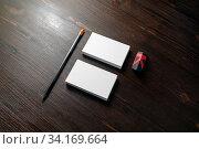 Купить «Photo of blank business cards, pencil and eraser on wood table background. Branding mock up.», фото № 34169664, снято 10 июля 2020 г. (c) easy Fotostock / Фотобанк Лори
