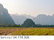 People hiking and riding bike in countryside of Vang Vieng, Laos. Стоковое фото, фотограф Zoonar.com/Ana Flašker / age Fotostock / Фотобанк Лори