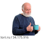 Neutral elderly white haired man showing thumb up with blue cup of tea or coffe isolated on white. Стоковое фото, фотограф Zoonar.com/Serghei Starus / easy Fotostock / Фотобанк Лори