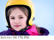 Winter portrait of a little girl wearing yellow ski helmet during skiing lesson. Стоковое фото, фотограф Zoonar.com/Pawel Opaska / easy Fotostock / Фотобанк Лори