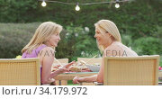 Купить «Dad and son talking to each other while having lunch outdoors», видеоролик № 34179972, снято 28 ноября 2019 г. (c) Wavebreak Media / Фотобанк Лори