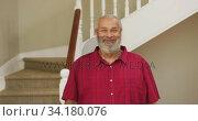 Купить «Senior man smiling at home», видеоролик № 34180076, снято 28 ноября 2019 г. (c) Wavebreak Media / Фотобанк Лори