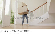 Young woman carrying cardboard boxes and putting inside the house. Стоковое видео, агентство Wavebreak Media / Фотобанк Лори