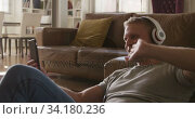 Купить «Caucasian male in social distancing working at home», видеоролик № 34180236, снято 20 июля 2019 г. (c) Wavebreak Media / Фотобанк Лори