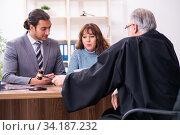 Купить «Young woman in courthouse with judge and lawyer», фото № 34187232, снято 25 ноября 2019 г. (c) Elnur / Фотобанк Лори