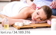 Купить «Young woman during spa procedure in salon», фото № 34189316, снято 26 февраля 2018 г. (c) Elnur / Фотобанк Лори
