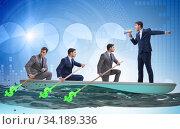Team of businessmen in teamwork concept with boat. Стоковое фото, фотограф Elnur / Фотобанк Лори