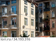 Купить «Urban renovated and neglected buildings closeup in sunny day», фото № 34193316, снято 15 июля 2020 г. (c) easy Fotostock / Фотобанк Лори