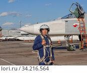Military pilot in helmet stands near jet plane. Стоковое фото, фотограф Zoonar.com/Alexander Strela / easy Fotostock / Фотобанк Лори