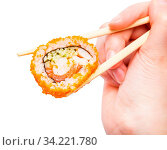 Female hand with disposable chopsticks holds california ebi sushi roll close up isolated on white background. Стоковое фото, фотограф Zoonar.com/Valery Voennyy / easy Fotostock / Фотобанк Лори