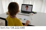 Unrecognizable child having video call with teacher on laptop indoors. Стоковое видео, видеограф Ekaterina Demidova / Фотобанк Лори