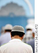 Muslim at the friday prayer (salat). Kufi hat. Стоковое фото, фотограф Fred de Noyelle / Godong / age Fotostock / Фотобанк Лори