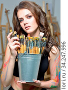 Portrait of the beatiful woman with brushes painting at art studio. Стоковое фото, фотограф Zoonar.com/© Dmitry Raikin / easy Fotostock / Фотобанк Лори
