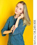 Torso Portrait of the beautiful blonde woman. Studio shooting with yellow background. Стоковое фото, фотограф Zoonar.com/© Dmitry Raikin / easy Fotostock / Фотобанк Лори