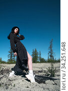 Woman in a spotted dress. Стоковое фото, фотограф Art Konovalov / Фотобанк Лори