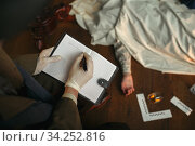 Male detective with cigar writes in notebook. Стоковое фото, фотограф Tryapitsyn Sergiy / Фотобанк Лори