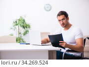Young disabled man working from house. Стоковое фото, фотограф Elnur / Фотобанк Лори