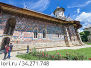 Tourists in Moldovita Monastery - Romanian Orthodox monastery located in commune of Vatra Moldovitei, Suceava County, Romania. Стоковое фото, фотограф Konrad Zelazowski / age Fotostock / Фотобанк Лори